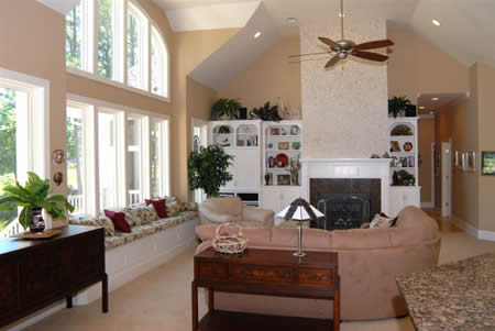 A fireplace and built-in display cabinets enhance the living room's sophisticated yet relaxed atmosphere.