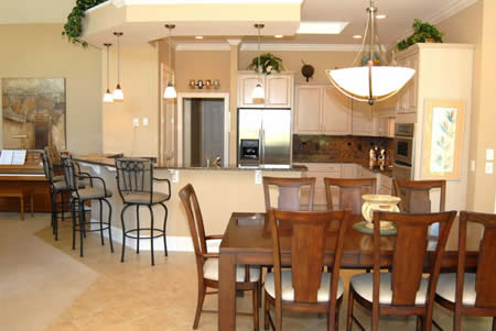 A well-planned kitchen adjoins the dining area offering abundant counter space and snack bar seating for casual dining.