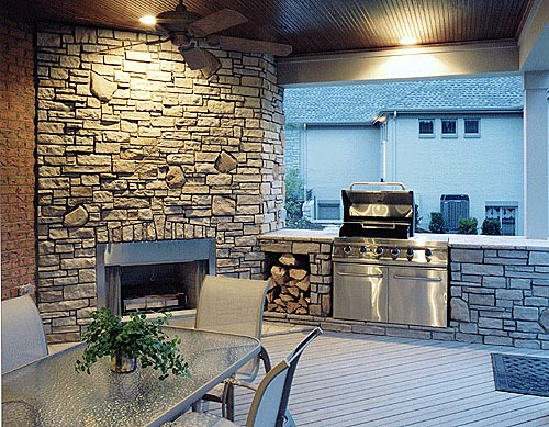 A fireplace and outdoor kitchen make the covered rear deck a favorite place to hang out.