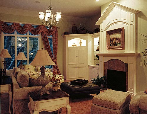 The great room's cozy fireplace draws attention with its striking details.