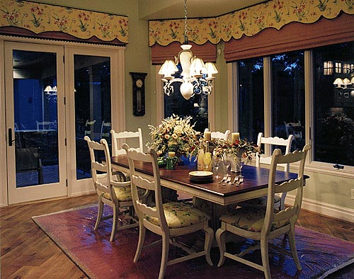 Bayed windows and patio doors bring the outdoors inside the spacious breakfast area.