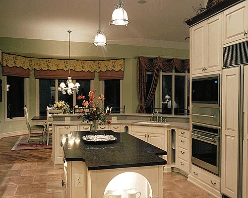 The well-planned kitchen features lots of counter space and a large work island.