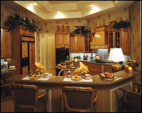 The kitchen is efficiently planned with a center island and wrapping counters.