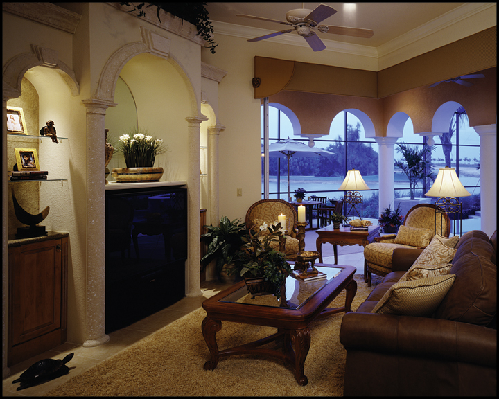 The gathering room enjoys both a corner entertainment center as well as open access to the covered lanai.