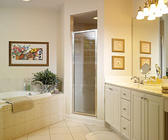 The pampering master suite is enhanced by a romantic fireplace and luxurious bath.