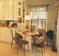 Sunshine brightens the breakfast area and kitchen.