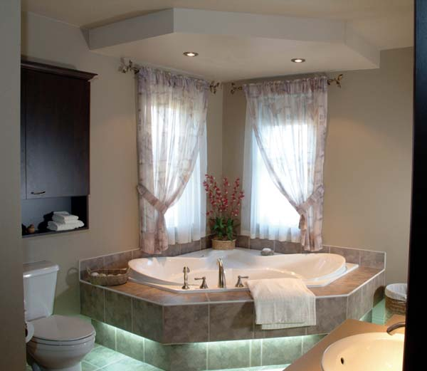 The charming master bath exudes a sense of luxury usually found in larger homes.