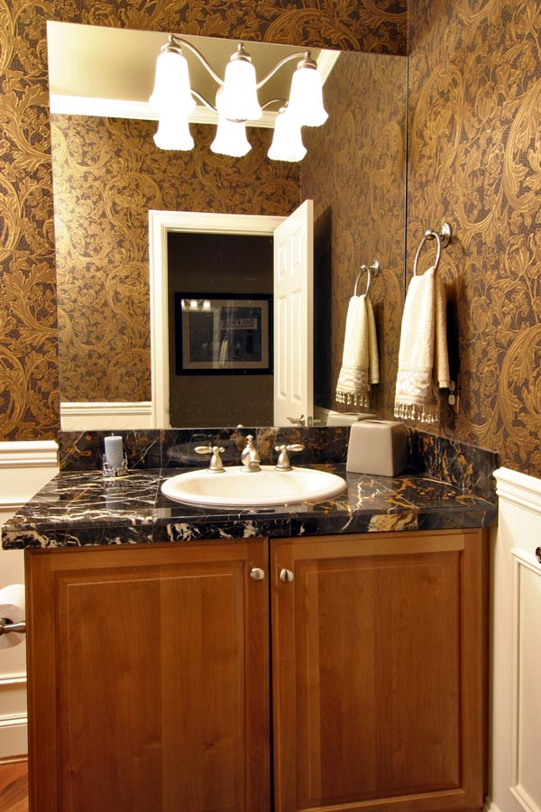 The main level's powder bath is discretely located for privacy.