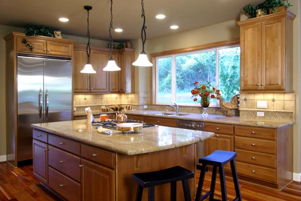 Plenty of workspace is provided by the kitchen's center island and countertops.