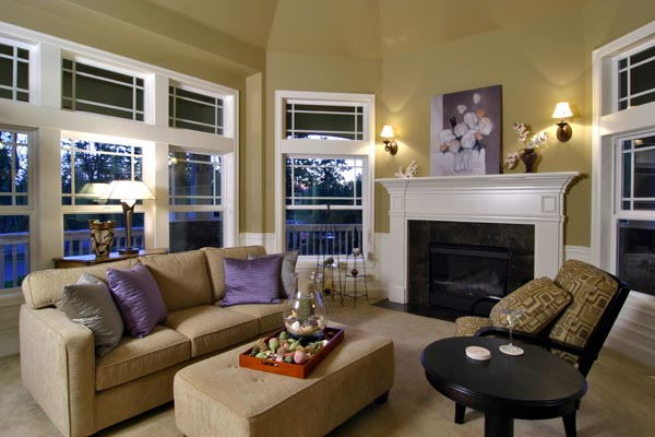The living room offers comfortable yet sophisticated entertaining space brightened by an abundance of windows.