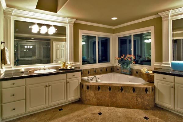 The master bath includes a decadent soaking tub flanked by his and her vanities.