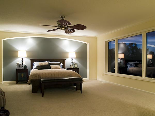 "The master bedroom's arched soffit creates an impressive ""frame"" for the bed."