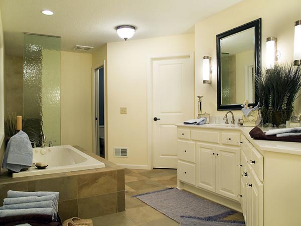 The luxurious master bath includes his and her vanities soaking tub and walk-in shower.