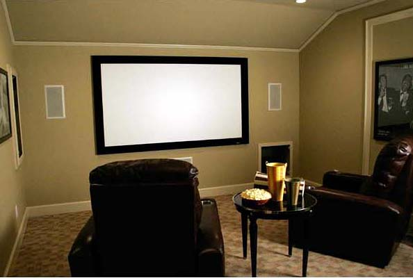 The upper-level media room is a favorite spot to relax with friends or family.